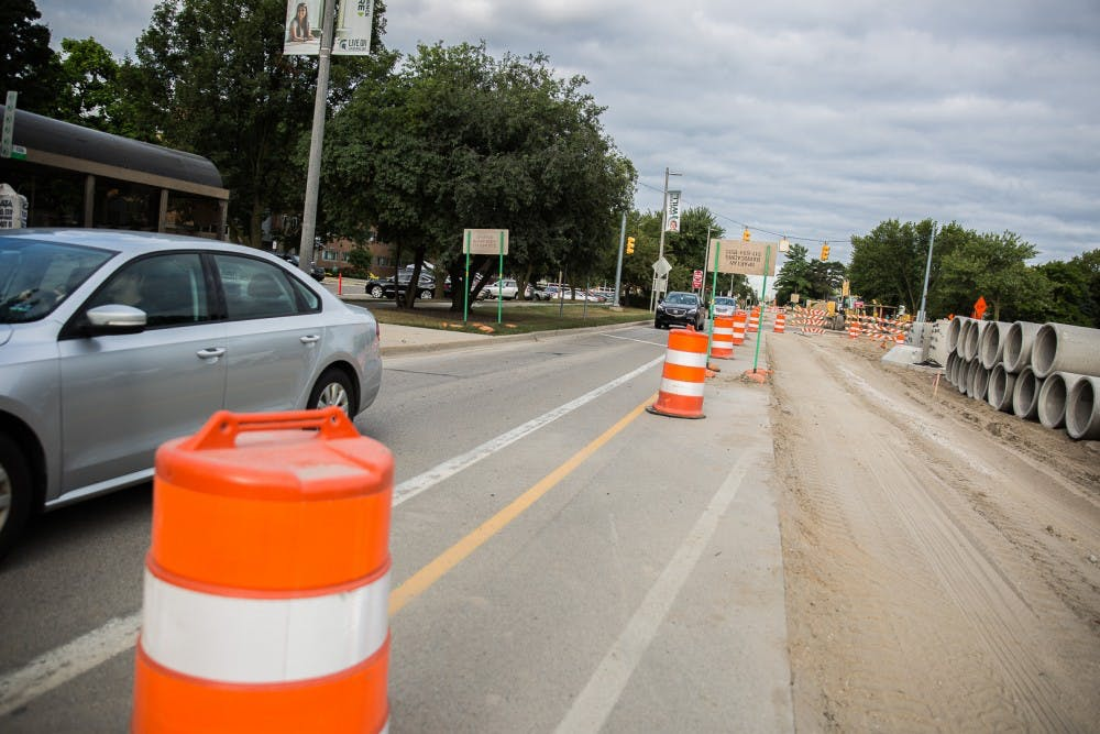 <p>Road construction is seen near Brody Hall on Aug. 25, 2019 in East Lansing. 