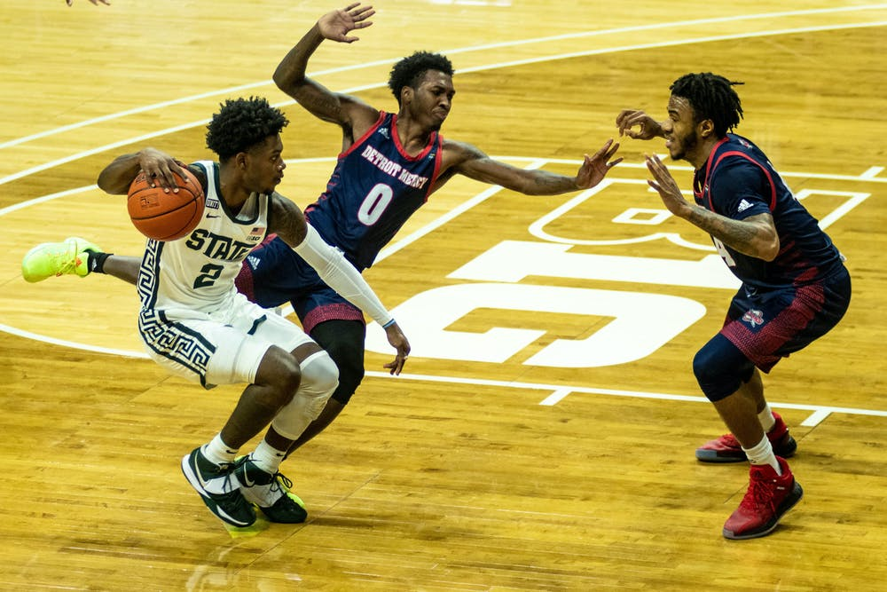 <p>Sophomore guard Rocket Watts (2) moves with the ball during the game against the Detroit Titans on Dec. 4, 2020, at the Breslin Center. The Spartans were tied with the Titans at halftime, 35-35.</p>