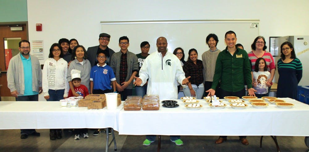 <p>Photo of past Thanksgiving Unity Day Dinner as students, adults and children come together to celebrate a traditional&nbsp;Thanksgiving dinner, Juan Flores is pictured far right wearing green shirt. Photo courtesy of Juan Flores.</p>