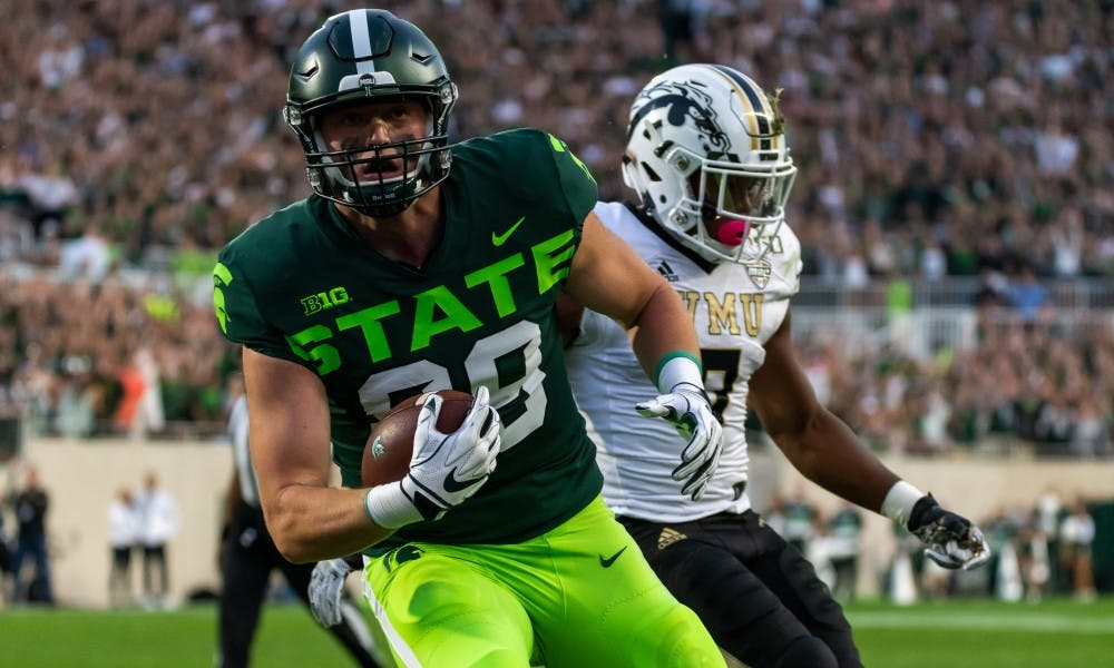 <p>Junior tight end Matt Dotson scores on a touchdown pass against Western Michigan. The Spartans defeated the Broncos, 51-17, on Sept. 7, 2019 at Spartan Stadium. </p>