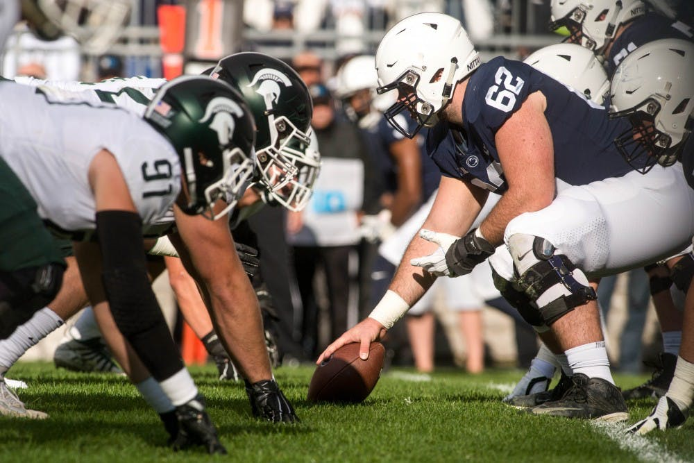 <p>MSU and Penn State line up during the game on Oct. 13, 2018 at Beaver Stadium. The Spartans defeated the Nittany Lions, 21-17.</p>