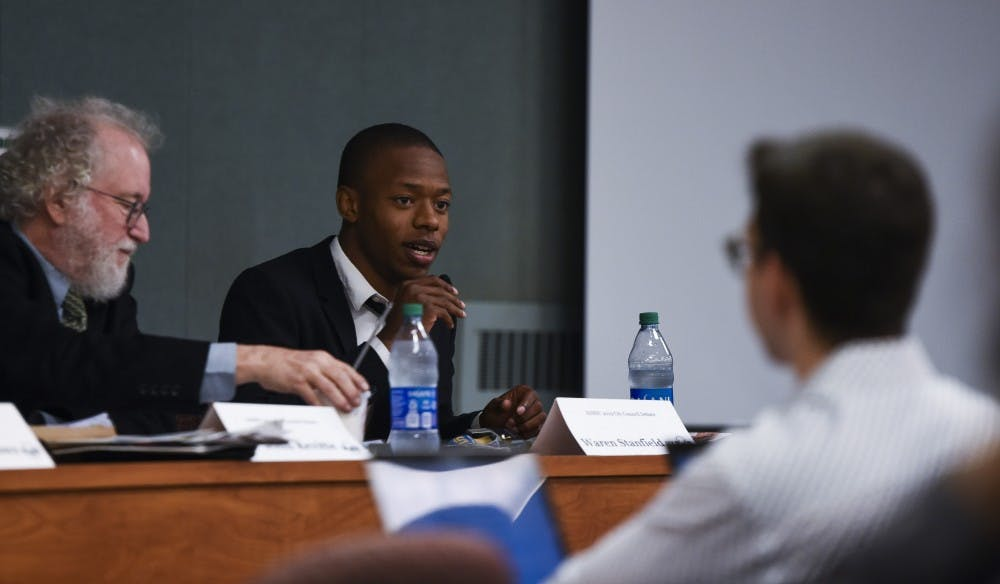 Warren Stanfield III speaks during ASMSU's East Lansing City Council candidate debate on Oct. 14, 2019 at the International Center.
