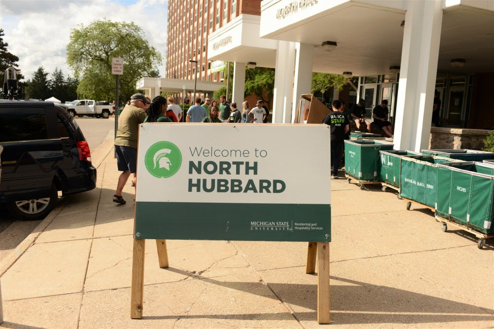 <p>Families of new and returning students pull up to North Hubbard Hall during Fall move in day on Aug. 25, 2019.</p>