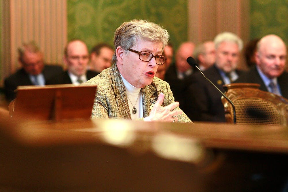 <p>MSU President Lou Anna K. Simon testifies Feb. 24, 2015, before a joint meeting of the state house and senate appropriations subcommittees on higher education at the Michigan state Capitol in downtown Lansing. Simon emphasized the ways MSU has cut costs after years of only slight funding increases.</p>