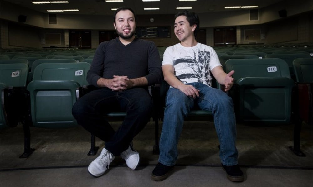 <p>&nbsp;From left to right, doctoral student Jose Badillo Carlos and doctoral student Osvaldo Sandoval pose for a portrait on Jan. 22, 2016 at Wells Hall. Carlos and Sandoval are both children of undocumented migrants and have paid international student tuition rates while attending MSU.</p> <p><strong>Emily Elconin | The State News</strong></p>