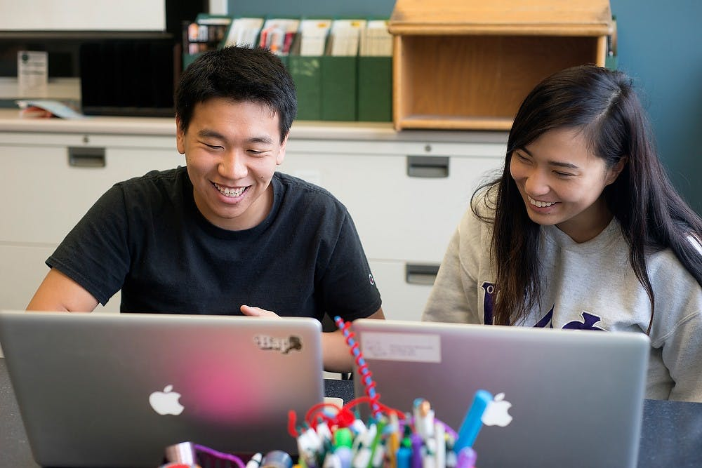 <p>Accounting sophomore Jiayun Sun receives help from psychology senior Rachel Huang while writing a personal statement for class Sept. 16, 2014, at the Writing Center at Bessey Hall. The center helps students strengthen their writing by providing one-on-one sessions. Julia Nagy/The State News</p>