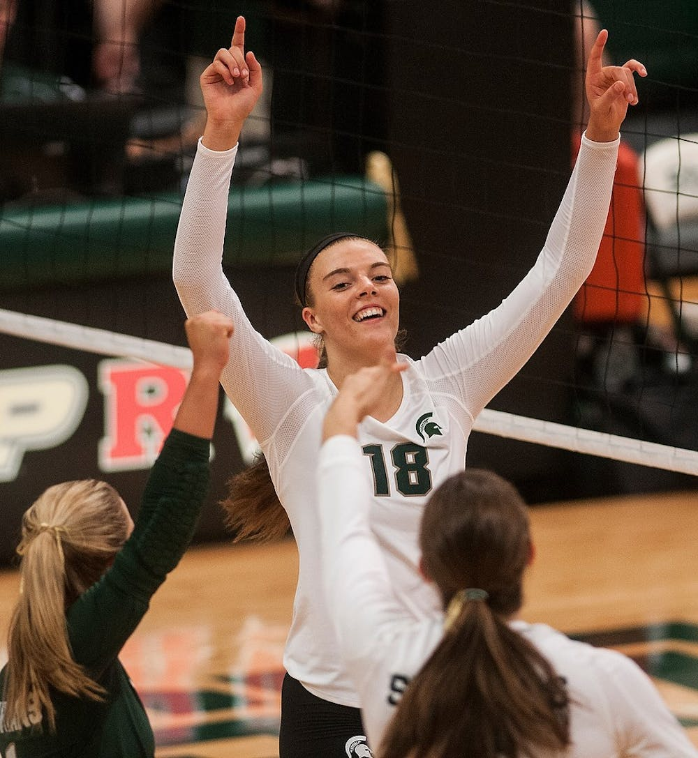 <p>Freshman outside hitter Holly Toliver celebrates with her teammates after scoring a point Sept. 6, 2014, at Jenison Fieldhouse during a game against Duke University. The Blue Devils defeated the Spartans, 3-2. Aerika Williams/The State News</p>