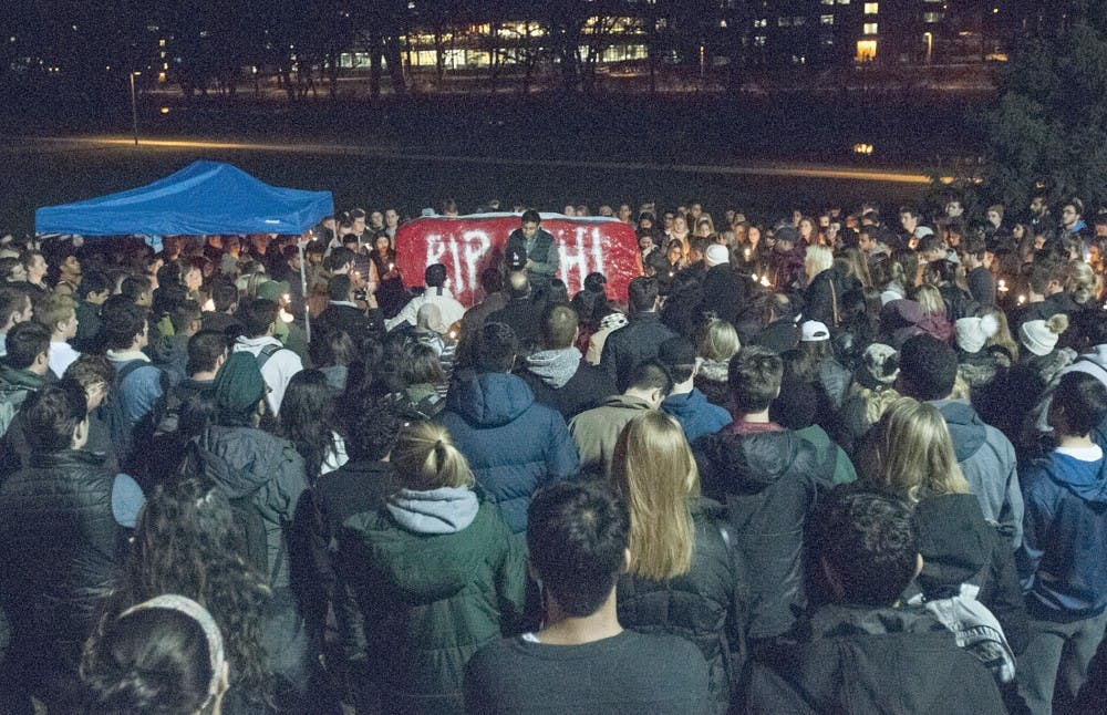Hundreds of friends and family members gather together for a candlelight vigil on Nov. 29, 2016 at The Rock to mourn the passing of former student Abhi Shah.