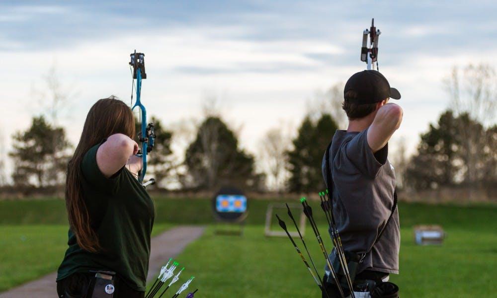 Political science junior Amber Arbegast (left) and advertising management sophomore Nick Massey shoot at the Demmer Shooting Center on April 22, 2019.
