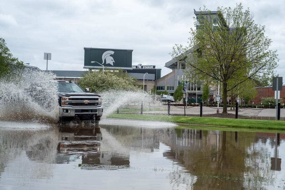 A car drives past Spartan Stadium on March 19, 2020