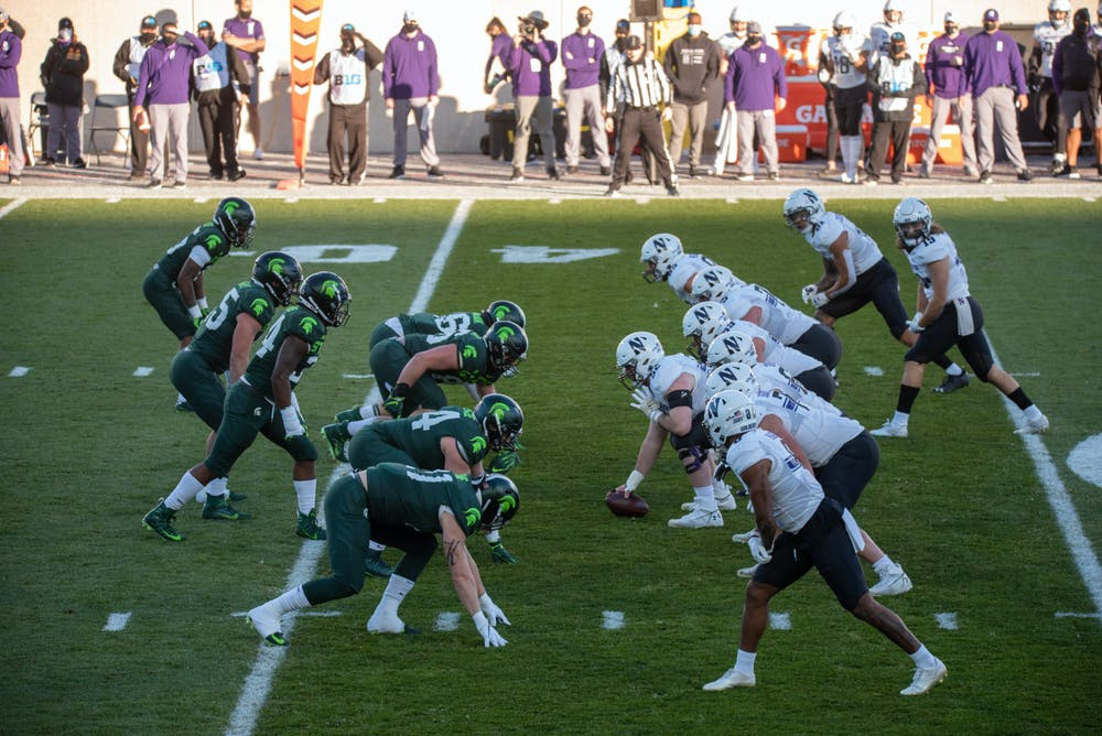 <p>Michigan State University defense lining up on the ball waiting for Northwestern&#x27;s offensive line to move on Saturday, Nov. 28, 2020.</p>