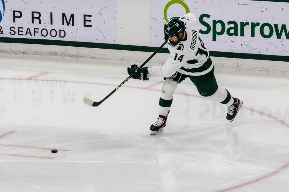 <p>Sophomore forward Adam Goodsir (14) shoots the puck against Notre Dame. The Spartans were defeated by the Fighting Irish, 2-1, at Munn Ice Arena on November 22, 2019. </p>
