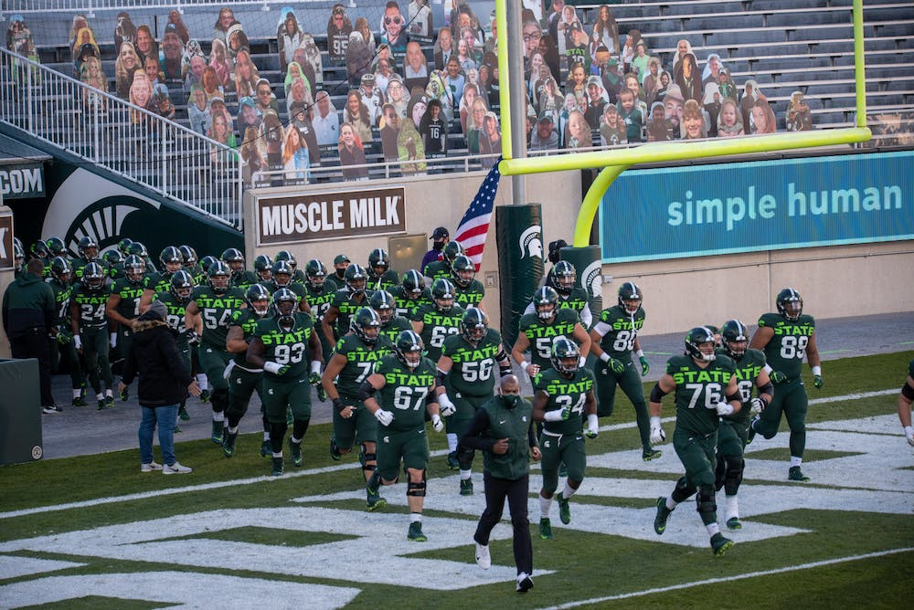 <p>Michigan State University&#x27;s football team leaving the tunnel to begin their game against Northwestern on Saturday, November 28, 2020. </p>