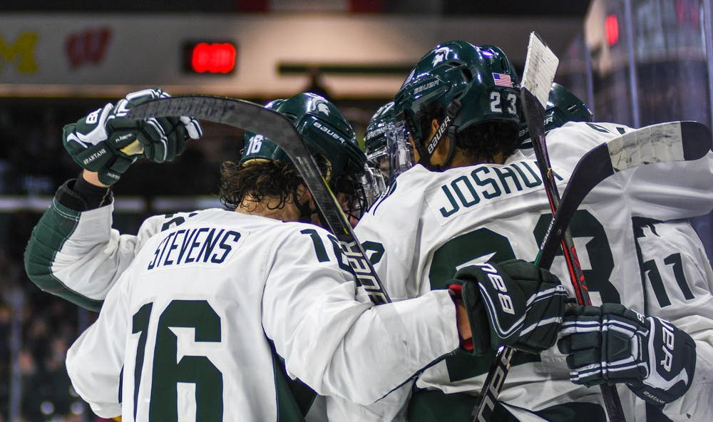 <p>The Spartans celebrate a goal during the game against Arizona on Dec. 14, 2019 at the Munn Ice Arena. The Sun Devils defeated the Spartans, 4-3.</p>