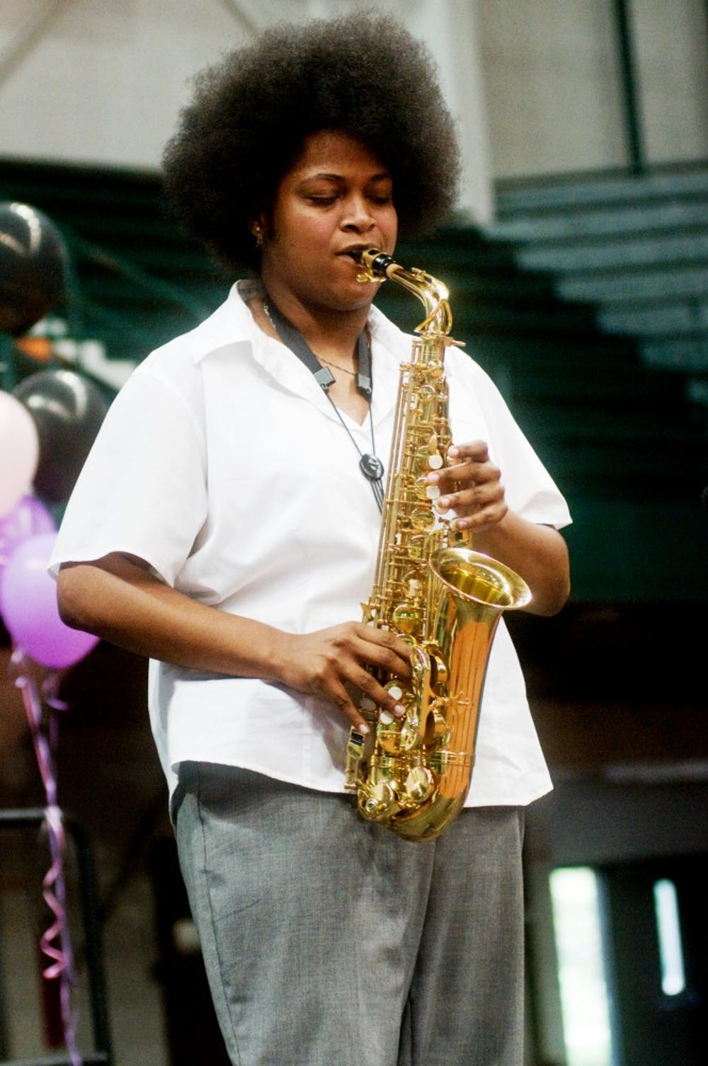 Music education senior Jessica Robins plays the saxophone Saturday evening at Cultural Remix held at Jenison Fieldhouse. Cultural Remix is a cultural celebration which showcases local performers and artists. Samantha Radecki/The State News