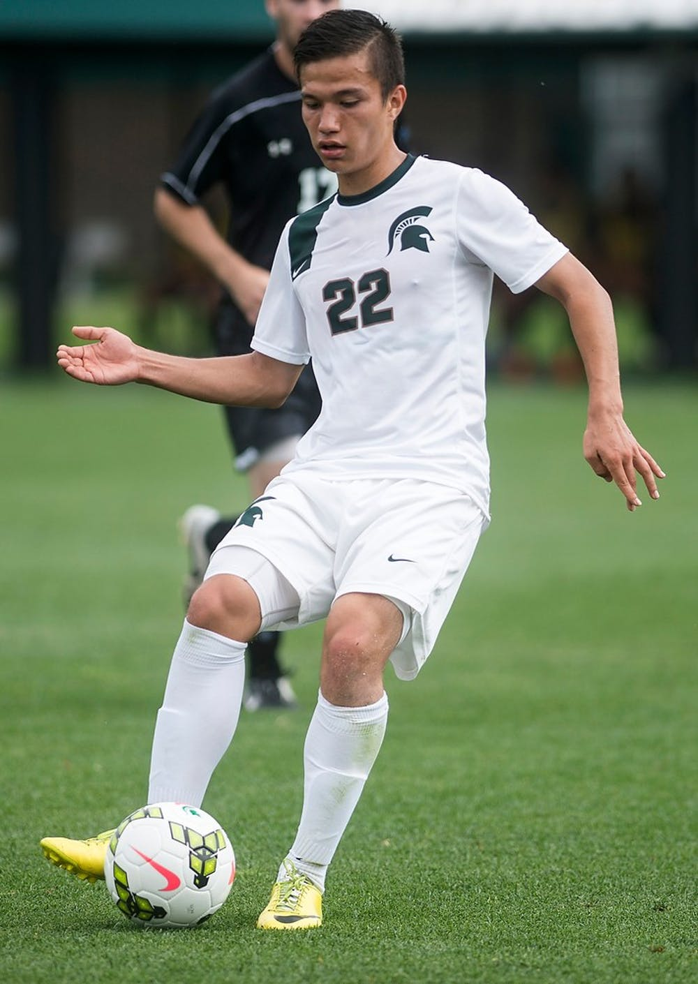 <p>Freshman midfielder Ken Krolicki kicks the ball Aug. 24, 2014, at DeMartin Soccer Stadium at Old College Field during a game against Stevens Institute of Technology. The Spartans defeated the Ducks, 4-0. Erin Hampton/The State News</p>
