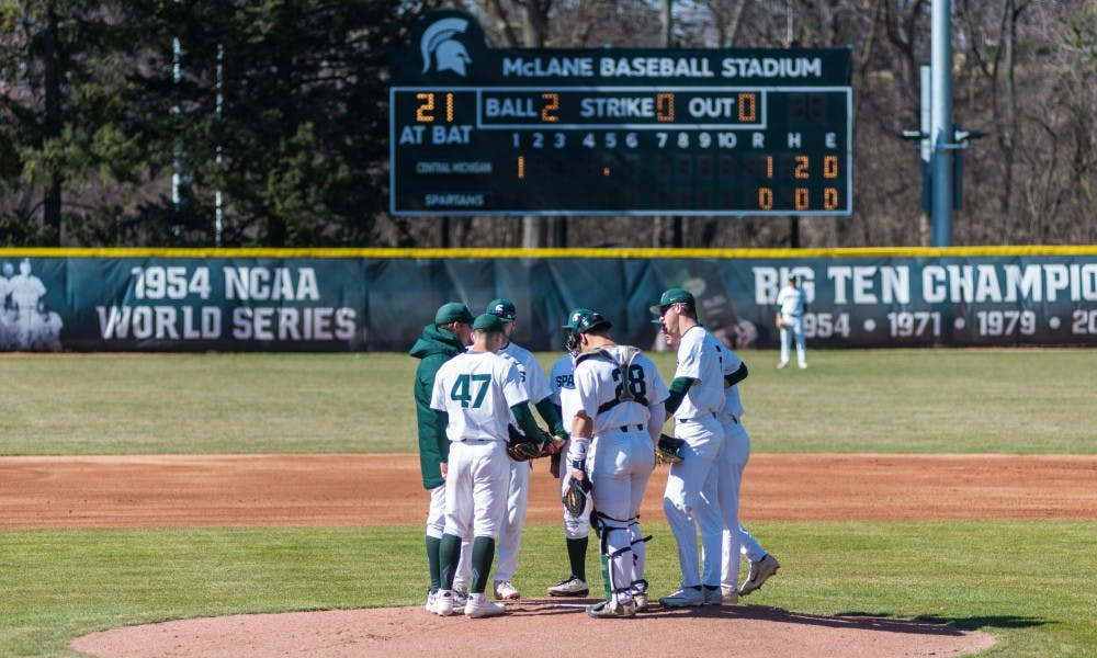 MSU players meet at the pitching mound in the first inning against Central Michigan. The Spartans lost the Chippewas, 6-8, at McLane Baseball Stadium on April 3, 2019.