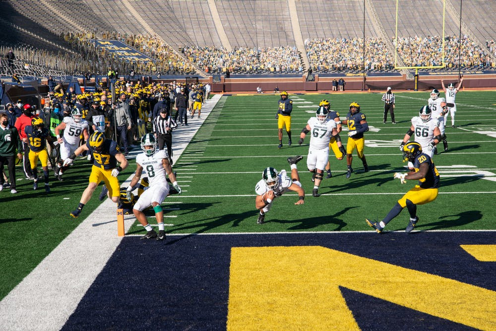 <p>Running back Connor Heyward (11) scores the game-winning touchdown for Michigan State in Ann Arbor, MI on Oct. 31, 2020.</p>