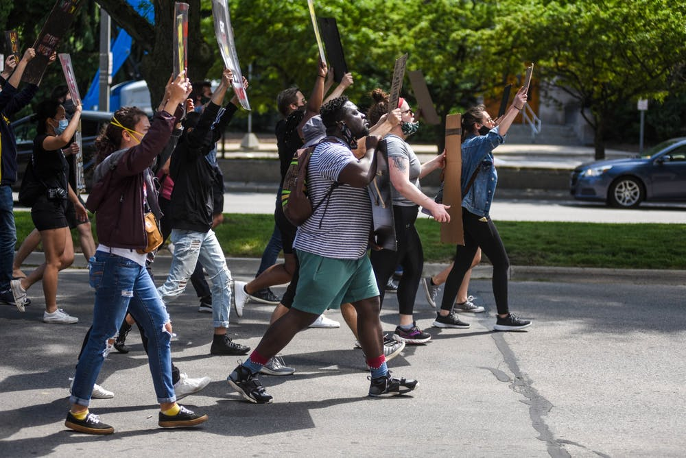 People march during a die-in protest June 12, 2020.