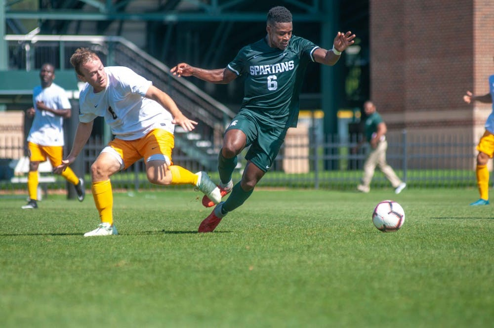 Senior forward Dejuan Jones (6) steals the ball during the game against Canisius on Aug. 31 at DeMartin Stadium. The Spartans defeated the Griffins; 3-2.