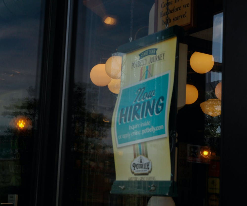 <p>A hiring sign is pictured at Potbelly on Grand River Ave. on June 23, 2021.</p>