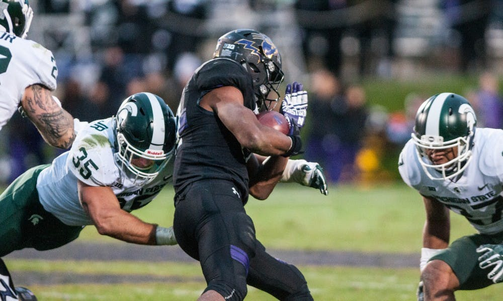 Sophomore linebacker Joe Bachie (35) makes a tackle during the game against Northwestern on Oct. 28, 2017, at Ryan Field. The Spartans fell to the Wildcats, 39-31, in 3OT.