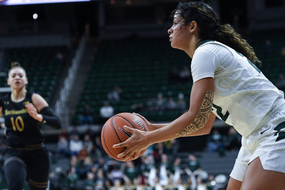 <p>Freshman guard Moira Joiner (22) prepares for a shot during a women's basketball game against Northwestern on Jan. 23, 2020 at the Breslin Center. The Spartans fell to the Wildcats 76-48.</p>
