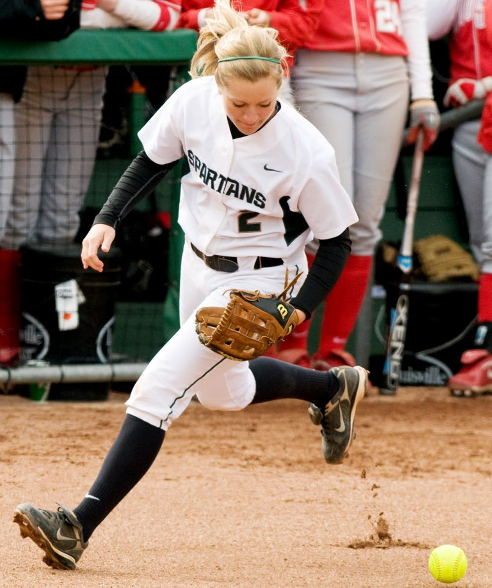 Junior third baseman Jayme O'Bryant attempts to field a ground ball Saturday afternoon at at Secchia Stadium at Old College Field. The Spartans lost 14-1 in their second game against the Buckeyes. Aaron Snyder/The State News.