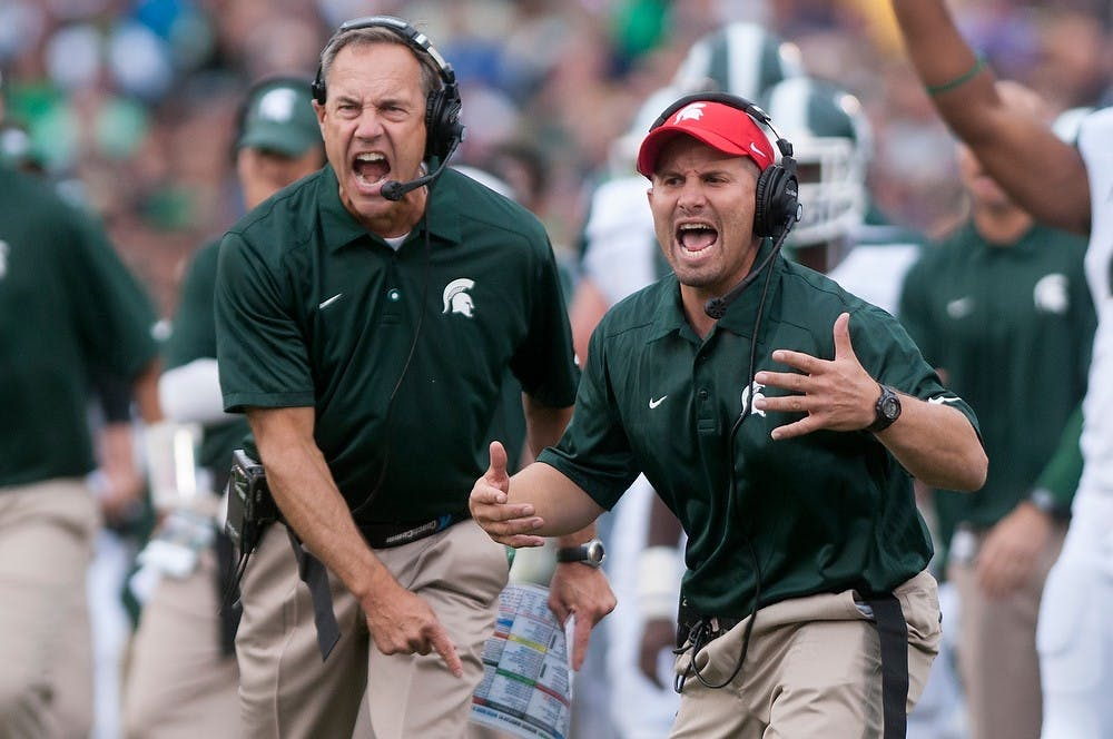 <p>Head coach Mark Dantonio, left, and linebackers/special teams coach Mike Tressel shout during the game against Notre Dame Sept. 21, 2013, at Notre Dame Stadium in South Bend, Ind. The Fighting Irish defeated the Spartans 17-13. Julia Nagy/The State News</p>
