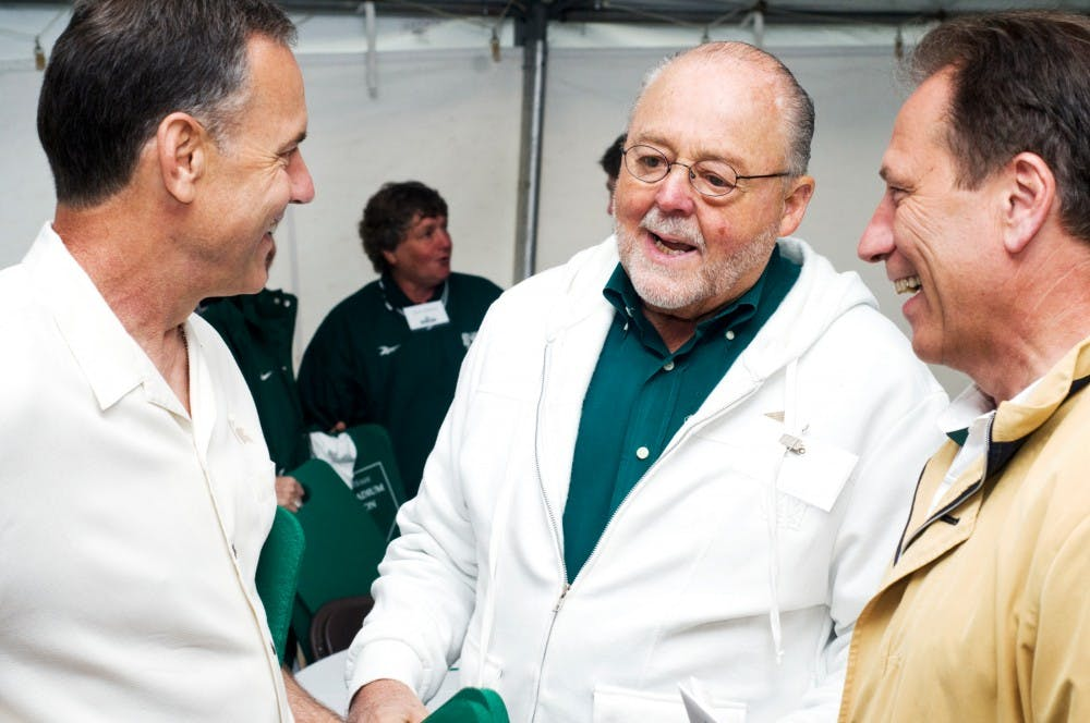 <p>MSU alumnus Ambassador Peter Secchia, center, talks in 2011 with football head coach Mark Dantonio, left, and basketball head coach Tom Izzo Saturday afternoon at the dedication of Secchia Stadium. Secchia donated a significant amount to the softball stadium which was named in his honor.</p>