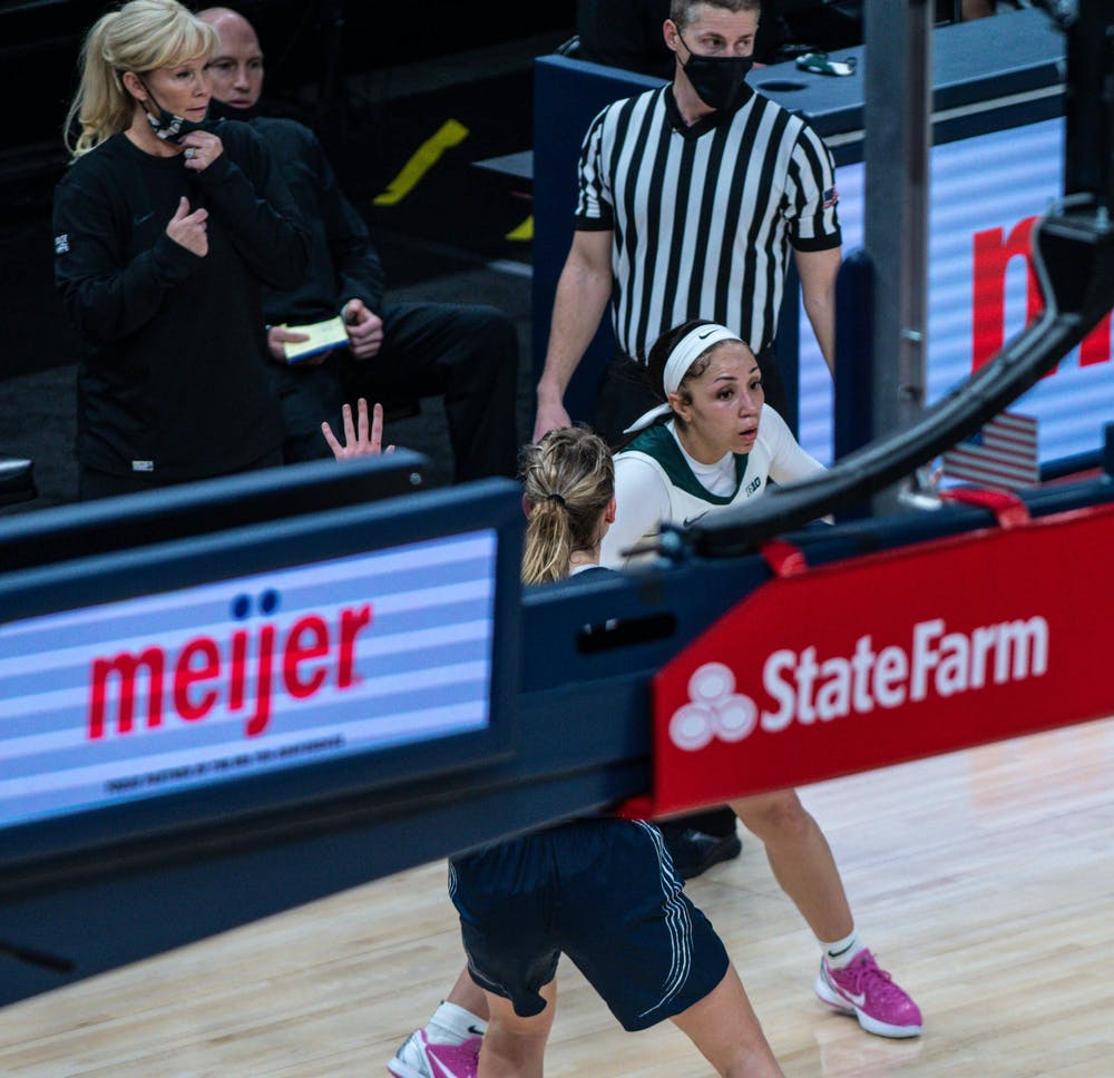 <p>Coach Suzy Merchant watches Alyza Winston and talks to her coaching staff in the third quarter. The Spartans defeated the Lady Lions, 75-66, on the second day of the Big Ten Tournament hosted at Bankers Life Fieldhouse in Indianapolis. Shot on March 10, 2021.</p>