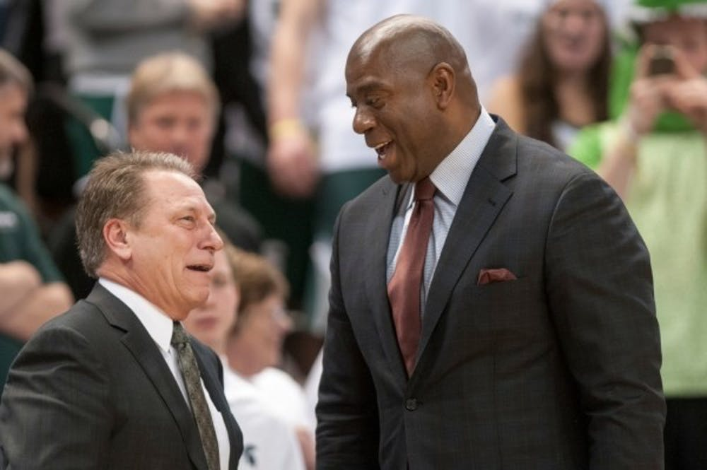 Men's basketball head coach Tom Izzo, left, laughs with former MSU basketball player Magic Johnson before the game against Indiana on Feb. 19, 2013, at Breslin Center.