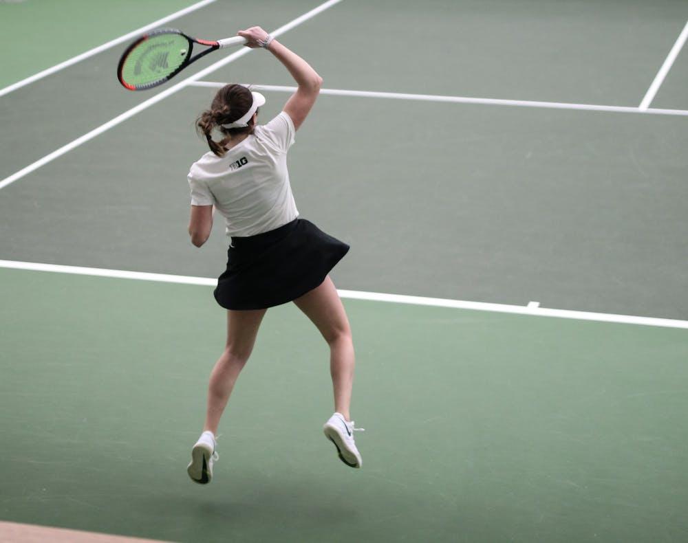Sophomore Lauren Lemonds returns a serve during a tennis meet against Montana on Feb. 8, 2020.