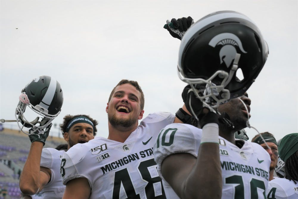 <p>MSU players celebrate following the game against Northwestern on Sept. 21, 2019 at Ryan Field. MSU defeated Northwestern, 31-10.</p>