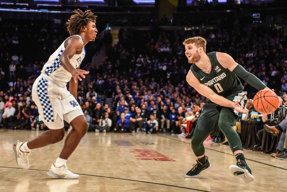 Redshirt-senior forward Kyle Ahrens (0) moves with the ball during the game against Kentucky at the State Farm Champions Classic at Madison Square Garden on Nov. 5, 2019. The Spartans fell to the Wildcats, 69-62.