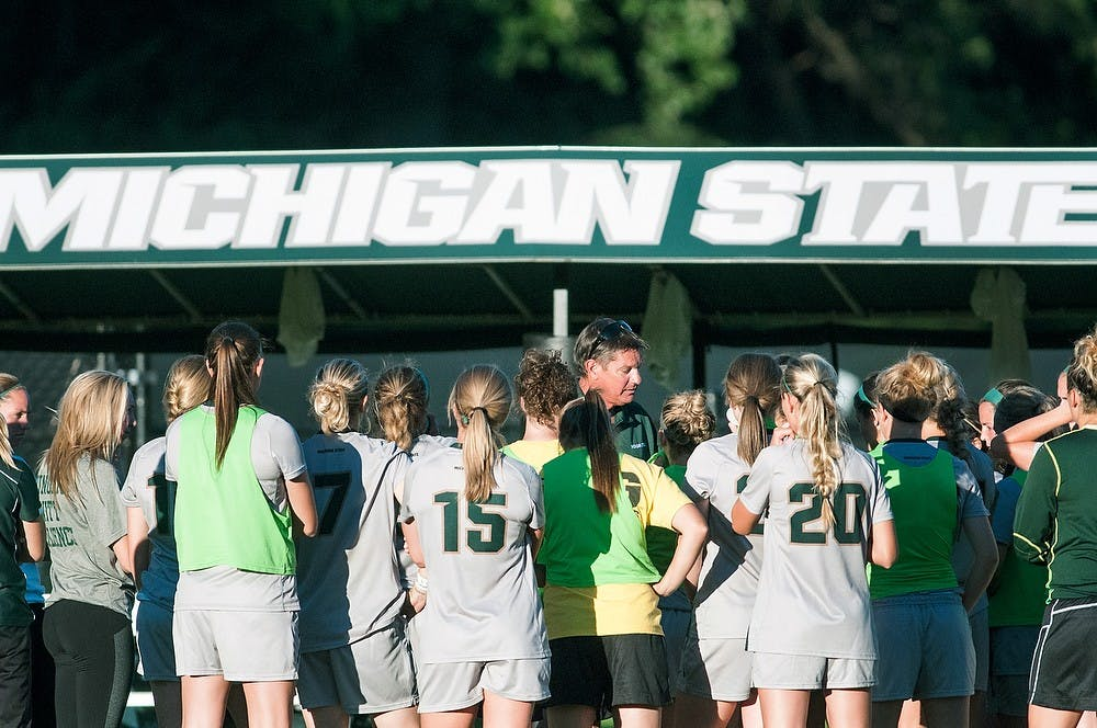 <p>Head coach Tom Saxton prepares his team for the overtime period Sept. 5, 2013, at DeMartin Stadium. The Spartans tied the Grizzlies, 1-1, after playing two scoreless overtime periods. Khoa Nguyen/ The State News</p>