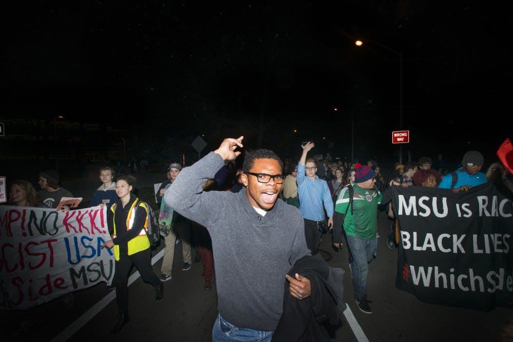 James Madison junior Edward Dance chants during a march on Nov. 10, 2016 at The Rock. The protest was organized by MSU college Democrats against hate, bigotry, racism and sexism.