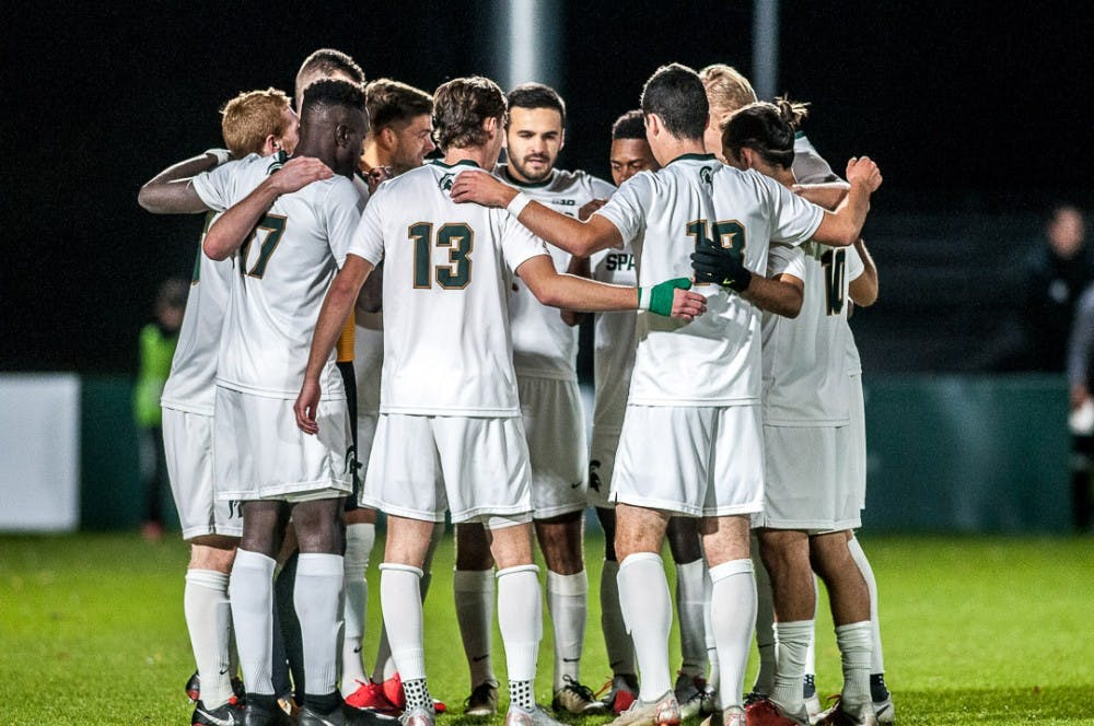 The Spartans huddle up before the game against Michigan on Oct. 23, 2018 at DeMartin Stadium. The game ended in a 1-1 tie between the Spartans and Wolverines with double overtime.