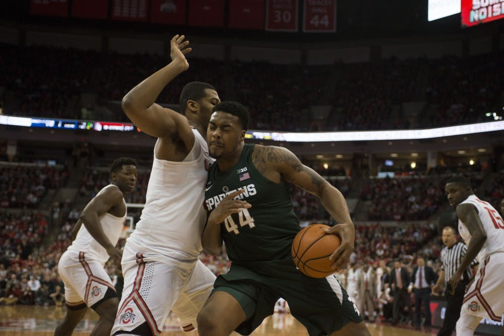 Sophomore guard Nick Ward pushes his way to get to the net during the MSU vs. Ohio State game. The Spartans lost 80-64