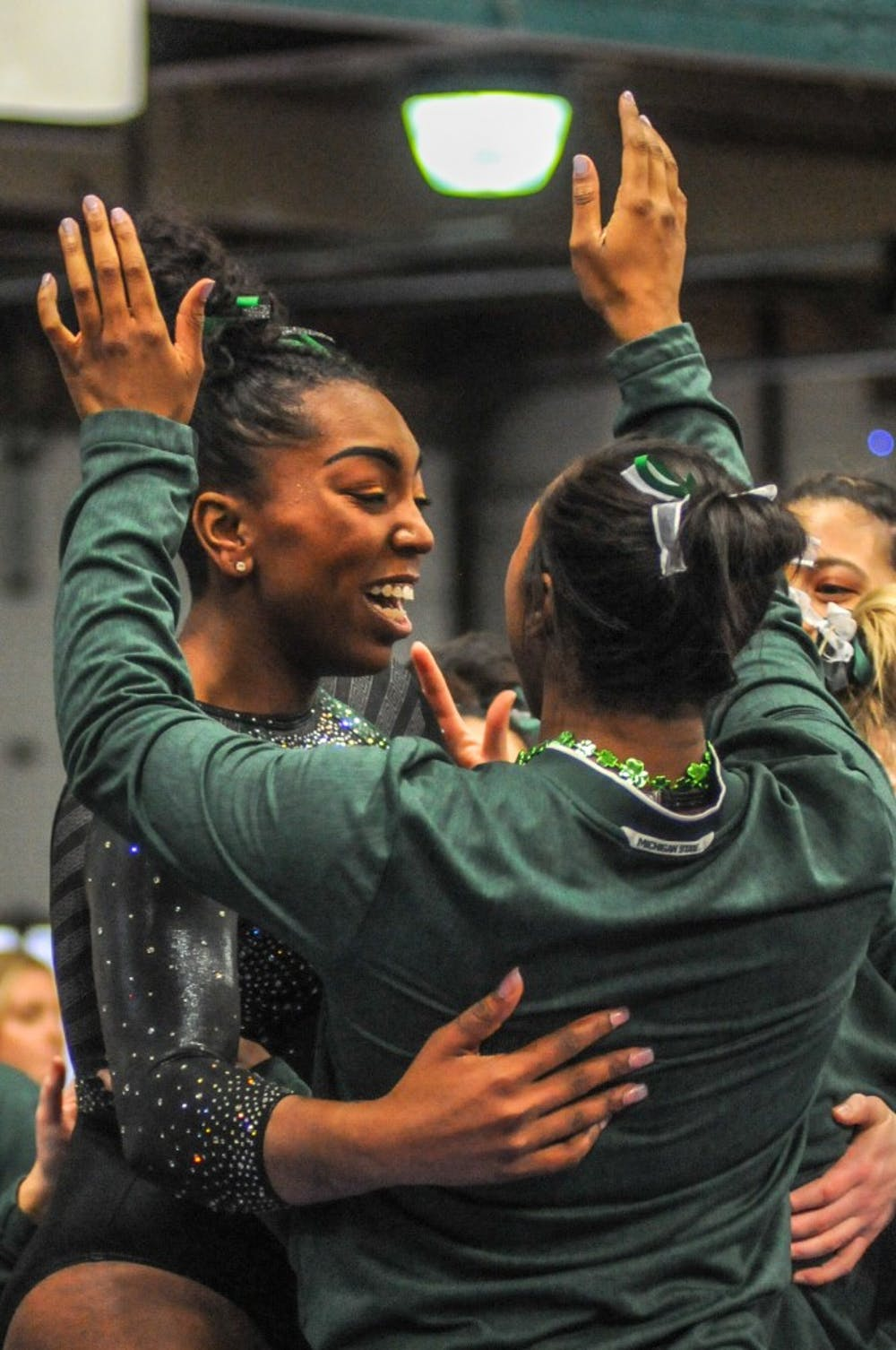 The Spartans celebrate at the women's gymnastics meet at Jenison Field House on March 17, 2019. The Spartans placed first against Alaska, Ball State, UIC.