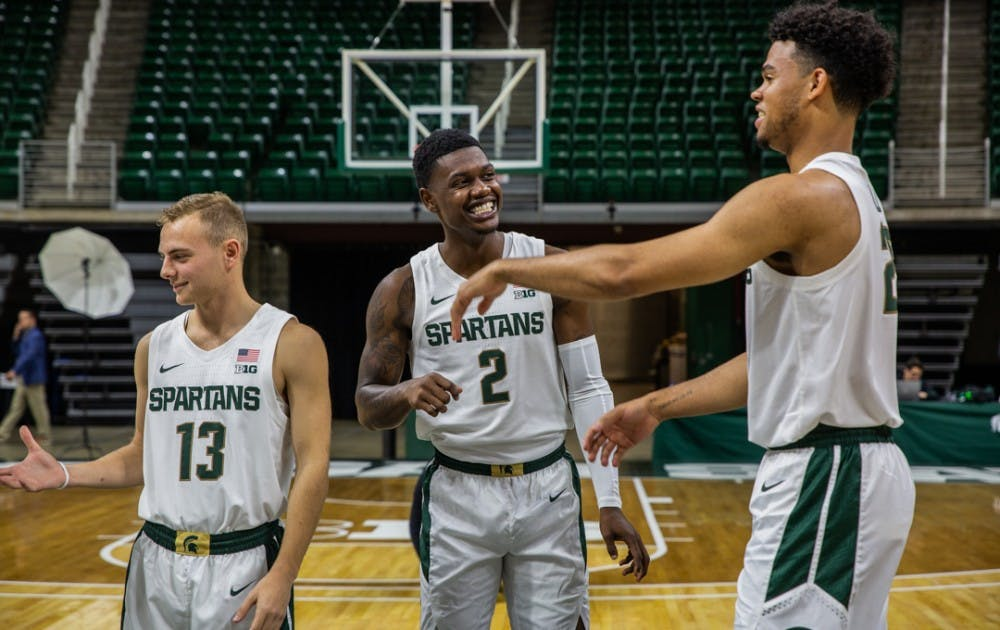 <p>Freshman guard Steven Izzo (13), freshman guard Rocket Watts (2) and freshman forward Malik Hall (25) during MSU basketball media day on Oct. 15, 2019 at the Breslin Center.</p>