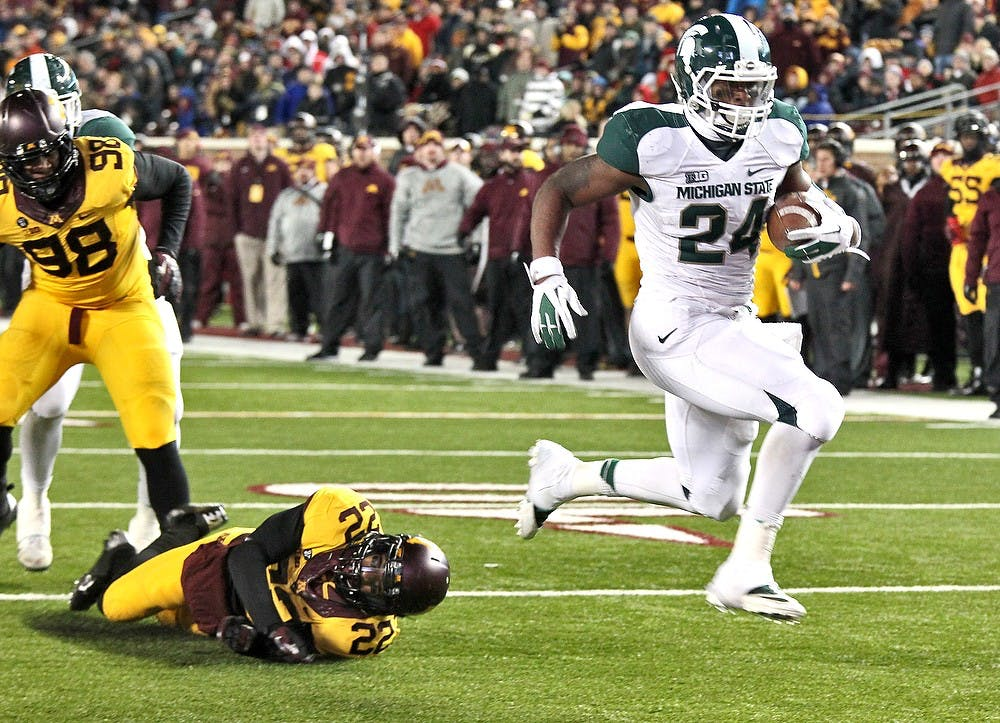 """<p>Junior running back Le&#8217;Veon Bell jumps into the end zone, leaving would-be Minnesota tacklers in his wake, on an 8-yard touchdown run in the fourth quarter at <span class=""""caps"""">TCF</span> Bank Stadium in Minneapolis, Minn. <span class=""""caps"""">MSU</span> won, 26-10, as Bell rushed for a career-high 266 yards on 35 carries on Saturday, Nov. 24, 2012. Martin Levison/Minneapolis Star Tribune/MCT</p>"""