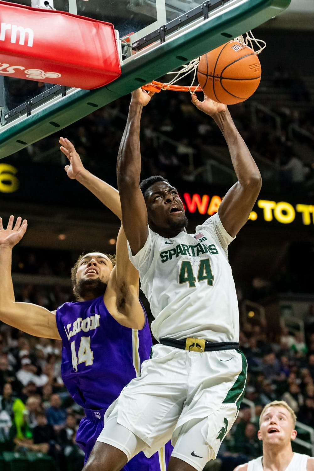 <p>Sophomore forward Gabe Brown dunks the ball against Albion College. The Spartans led the Britons, 40-25, at half at the Breslin Student Events Center on Oct. 29, 2019. </p>
