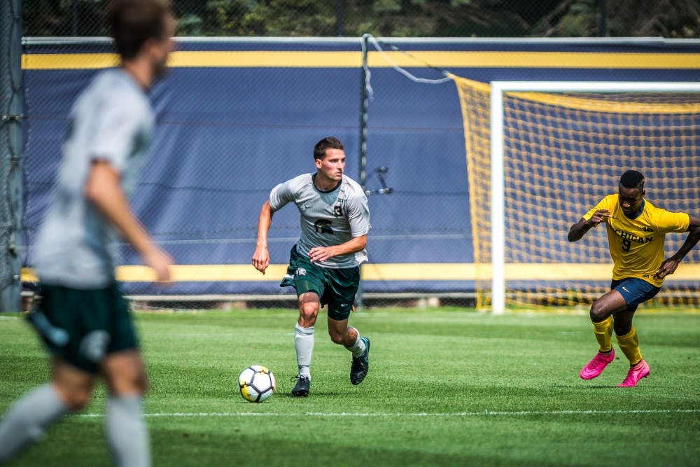 Senior defender Jimmy Fiscus (3) scans the field during the game against the University of Michigan on Sept. 17, 2017 at U-M Soccer Stadium. The Spartans defeated the Wolverines, 1-0.