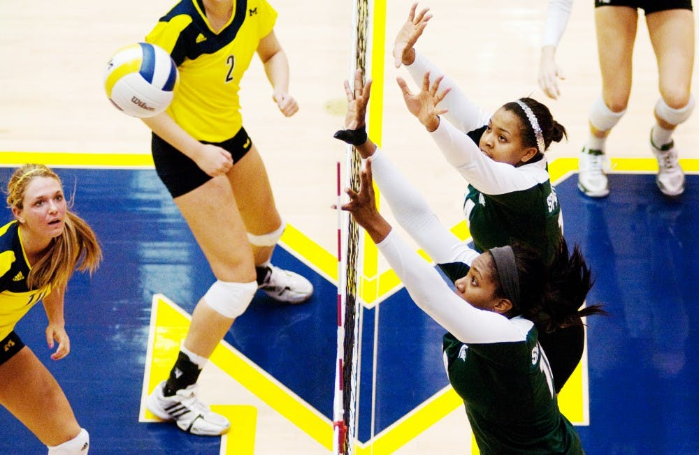 Senior outside hitter Kyndra Abron and freshman middle blocker Jazmine White go up to block a spike against U-M. The Spartans lost to the Wolverines, 3-1, on Wednesday evening at Cliff Kreen Arena in Ann Arbor. Josh Radtke/The State News