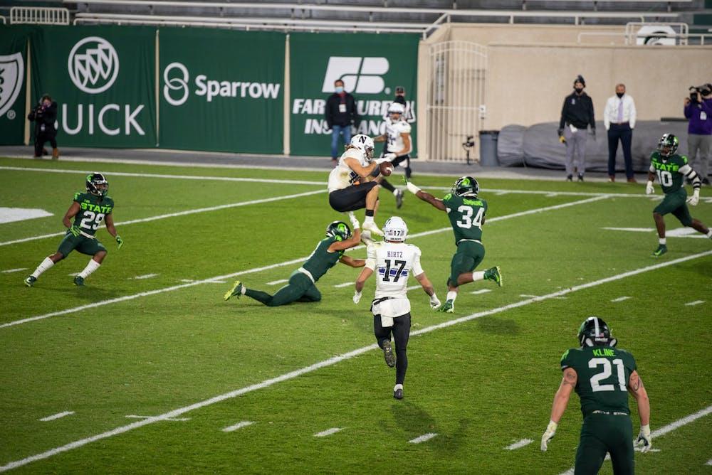 <p>Michigan State University&#x27;s Antjuan Simmons making a tackle midair against Northwestern on Saturday, November 28, 2020.</p>