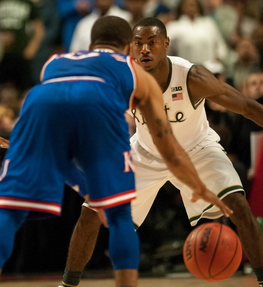 <p>Sophomore guard Lourawls Nairn Jr. defends Kansas guard Frank Mason III during the game against Kansas on Nov. 17, 2015 at United Center. The Spartans defeated the Jayhawks,&nbsp;</p><p>79-73.</p>