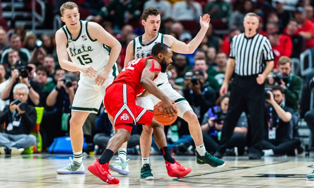 <p>Freshman guard Foster Loyer (right) draws an offensive foul from Ohio State&#x27;s Keyshaun Woods. The Spartans beat the Buckeyes, 77-70 at the United Center on March 15, 2019.</p>