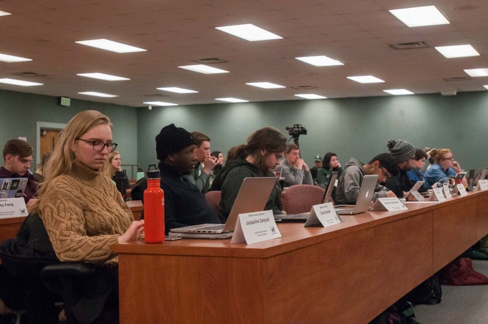 The general assembly sits during the debate about the bill to condemn MSU administration in regards to their handling of the Larry Nassar case on Jan. 18, 2018, at the MSU International Center. The bill passed with a unanimous vote.