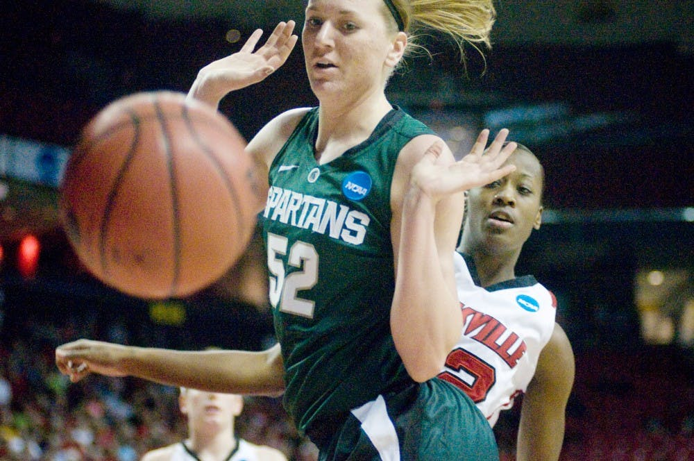 Freshman forward Becca Mills lets the ball go out of bounds during the women's basketball game against Louisville Saturday at the University of Maryland's Comcast Center in College Park, MD. The Spartans were defeated by the Louisville Cardinals, with a final score of 67-55. Derek Berggren/The State News